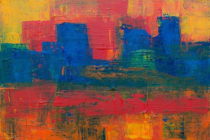 Una pintura abstracta de colores brillantes con una fotografía de textura gruesa de empaste de la pintura